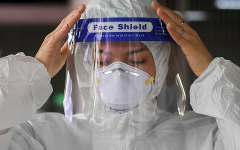 A health worker gets ready to collect samples during proactive testing of migrant workers at their work place, amid the spread of the coronavirus disease (COVID-19) outbreak in Samut Sakhon province in Thailand. (REUTERS)
