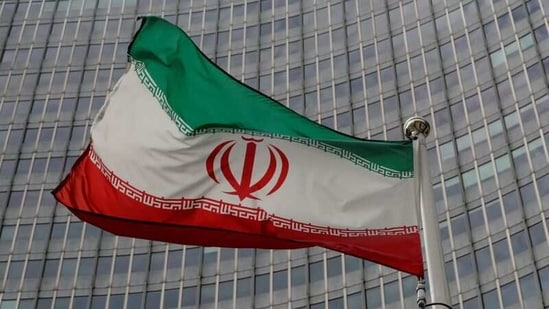 An Iranian flag flutters in front of the International Atomic Energy Agency (IAEA) headquarters in Vienna, Austria.(File Photo / REUTERS)