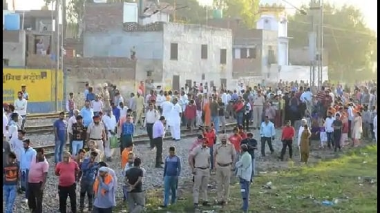 People gather near the site of a train accident at Joda Phatak in Amritsar on Saturday, a day after a train mowed down scores of people watching the Dussehra celebrations (AFP file)