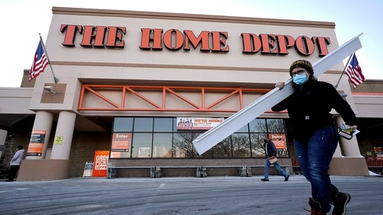 Passers-by walk near an entrance to a Home Depot home improvement store in Boston. (AP)