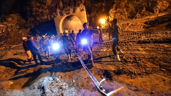 A focal point of the rescue work has been efforts to penetrate through tonnes of silt, sludge and debris to get to the people who were at work inside the 1,500 metre tunnel when the waters came rushing in.(Arun Sharma / PTI)