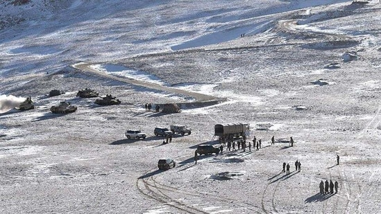 People Liberation Army (PLA) soldiers and tanks during military disengagement along the Line of Actual Control (LAC) at the India-China border in Ladakh. (AFP)(HT_PRINT)