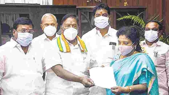 Puducherry Chief Minister V Narayanasamy hands over his resignation letter to Lt Governor Dr Tamilisai Soundararajan after he failed to prove his majority in the assembly, in Puducherry, Feb. 22. (PTI)