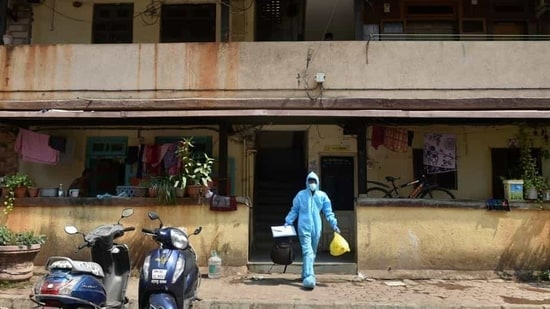A health worker leaves a residential area after conducting swab tests for Covid-19.(PTI)
