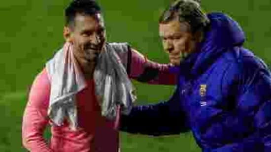 Barcelona's Lionel Messi, left, and Barcelona's head coach Ronald Koeman.(AP)