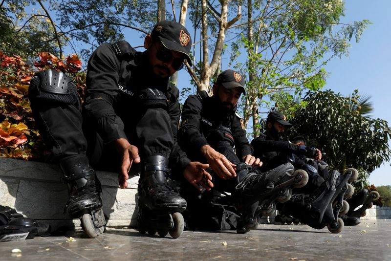 Special Security Unit (SSU) police members put on their rollerblades during practice at the headquarters in Karachi, Pakistan.(REUTERS)