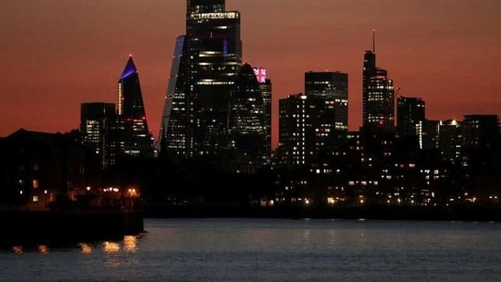 The sun sets over the skyscrapers of the City of London financial district, amid the coronavirus disease (Covid-19) outbreak in London, Britain.(Reuters)