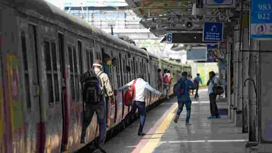 Commuters at Kurla railway station after Central Railways resumed local train service for essential staff. (HT file)