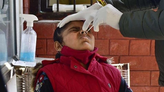 A swab sample being taken from Amritsar on Tuesday. Concerned schools are now closed for 48 hours for sanitization.(HT photo)