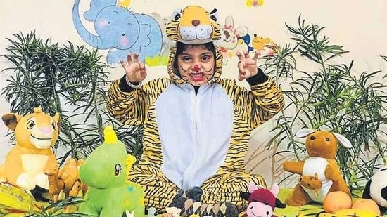 A child dressed as a tiger during a 'Jungle party' organised by Doon International School, Amritsar.