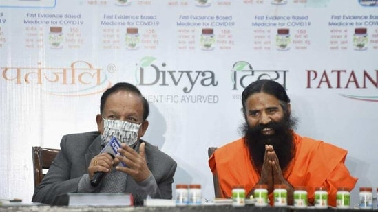 Union minister Harsh Vardhan with Ramdev at the launch of Patanjali's Coronil medicine, in New Delhi on February 19. (File photo)(HT_PRINT)