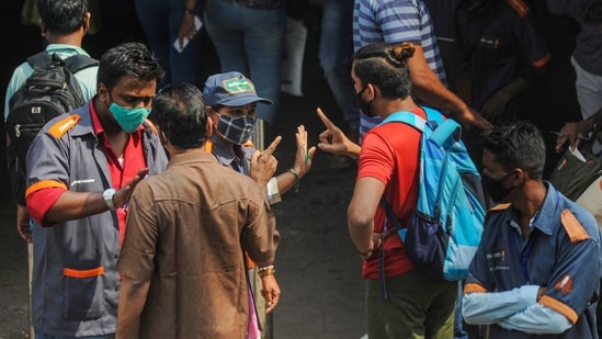 Mumbai: BMC officials penalise a commuter for not wearing masks, amid rise in coronavirus cases across Maharashtra, in Mumbai, Tuesday, Feb. 23, 2021. (PTI Photo)(PTI02_23_2021_000222A)(PTI)