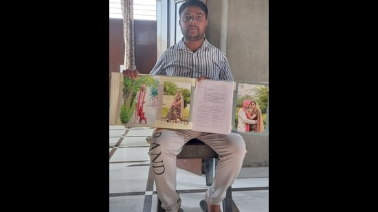 Jaswinder Singh of Barnala, who spent <span class='webrupee'>₹</span>18 lakh to send his wife to Canada on a study visa, shows a copy of the complaint and his wedding pictures. (HT Photo)