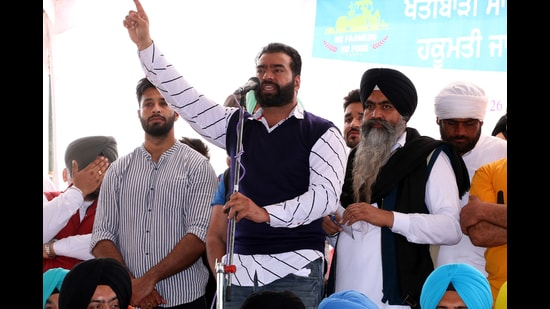 Lakha Sidhana, wanted by Delhi Police in the Republic Day violence case, speaking at a rally in Mehraj villageof Punjab's Bathinda district on Tuesday. (Sanjeev Kumar /HT)
