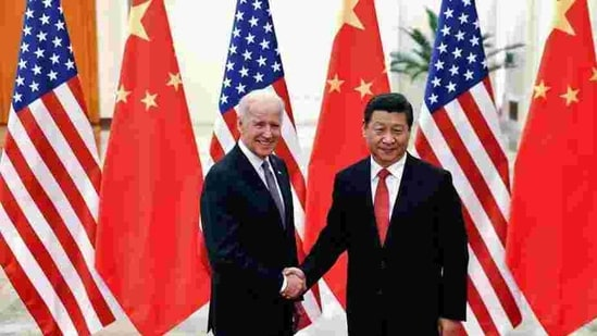Chinese President Xi Jinping shakes hands with then US vice president Joe Biden in Beijing on December 4, 2013. (Reuters File Photo )