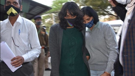 Environment activist Disha Ravi (centre) is escorted after being granted bail, outside Tihar jail in New Delhi on February 23. (AFP)