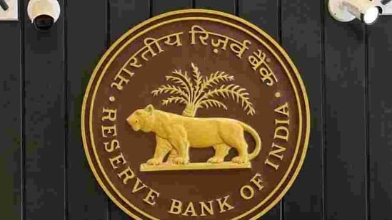 CCTV cameras are seen installed above the logo of Reserve Bank of India (RBI) inside its headquarters in Mumbai.(REUTERS)