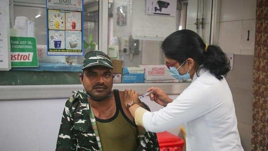 CRPF personnel being vaccinated against Covid-19, at Hindu Rao Hospital in New Delhi. (Sanchit Khanna/HT Photo)