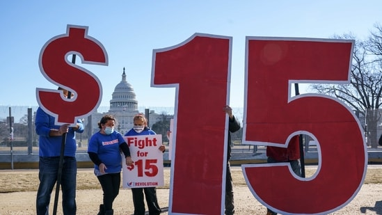 Activists appeal for a $15 minimum wage near the Capitol in Washington, Thursday, Feb. 25, 2021.(AP)