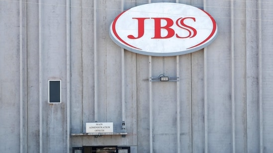 Employees walk around with face masks at the JBS USA meat packing plant,(Reuters)
