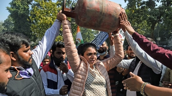 Indian youth Congress members protest against the hike in prices of petrol, diesel and LPG cylinders outside Shastri Bhawan, in New Delhi on Saturday. (ANI Photo)