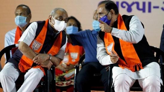 Gujarat Chief Minister Vijay Rupani interacts with Deputy Chief Minister Nitin Patel.(ANI file photo)