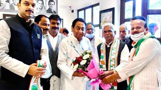 Corporator Babulal Chaurasia joins Congress in the presence of former Chief Minister of Madhya Pradesh Kamal Nath on February 25, 2021(ANI Photo)