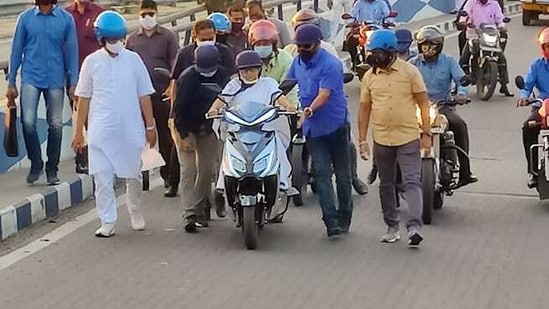 West Bengal chief minister Mamata Banerjee trying to ride an electric scooter in Kolkata on Thursday. (ANI Photo)