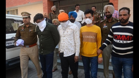 Shamsher Singh 'Shera' and his two aides in Police custody in Amritsar on Thursday. (ht photo)