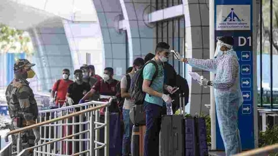 People wait in queue outside an airport. (HT FILE)