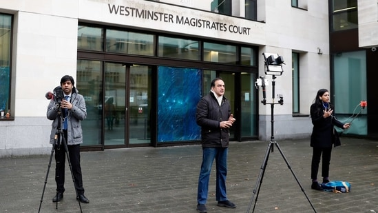Journalists report the verdict to allow the extradition of Nirav Modi, outside Westminster Magistrates Court, in London, Thursday, Feb. 25, 2021. Diamond tycoon Nirav Modi has lost his bid to avoid extradition from Britain to India to face allegations he was involved in a $1.8 billion bank fraud. District Judge Samuel Goozee ruled in London on Thursday that the jeweler has a case to answer before the Indian courts. (AP Photo/Alastair Grant)(AP)