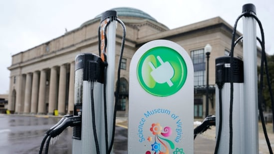 An electric car charging station is positioned outside the Science Museum where Virginia State Senators are meeting for their 2021 legislative session in Richmond, Va., Thursday, Feb. 18, 2021. Virginia lawmakers are considering final passage for a bill that aims to reduce carbon pollution by getting more electric vehicles on the road. (AP Photo/Steve Helber)(AP)
