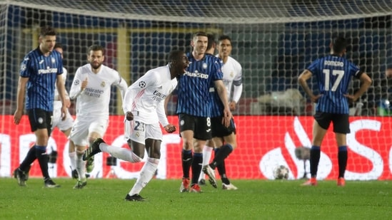 Real Madrid's Ferland Mendy celebrates after scoring his side's opening goal during the Champions League, round of 16, first leg soccer match between Atalanta and Real Madrid, at the Gewiss Stadium in Bergamo.(AP)