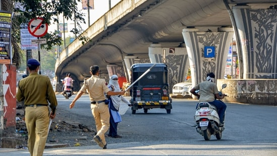 Police in Amravati stop commuters after a restriction was imposed due to an increase in Covid-19 cases on Wednesday.(PTI)