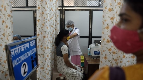 A Covid-19 vaccine shot being administered at Shatabdi Hospital. (Satish Bate/HT Photo)