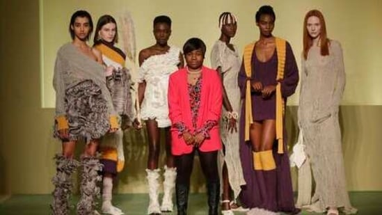 Fashion designer Gisele Claudia poses with models during the Black Lives Matter Fall/Winter 2021/22 collection collective show, presented in Milan, Italy, Wednesday, Feb. 17, 2021. 2021.(AP)