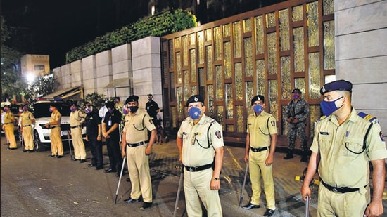 Police personnel stand guard outside Mukesh Ambani's residence Antilla after explosives were found in an abandoned car in its vicinity, in Mumbai, on Thursday. (Bhushan Koyande / Hindustan Times)