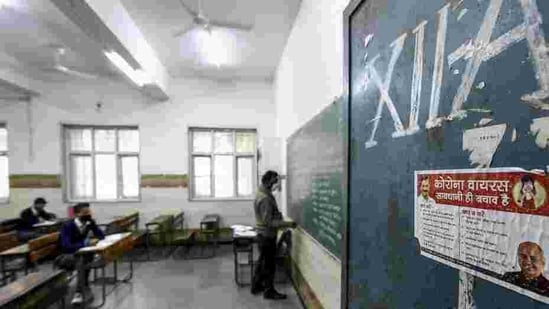 A teacher takes a class in a Delhi school. Schools in the national capital reopened for students of classes 10 and 12 on Monday.(HT_PRINT)