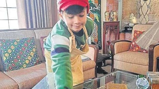 A student of Amity International School, Mohali, cleaning his home.