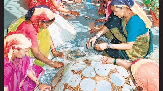 At Lijjat, members roll dough on special platforms for uniformly sized papads. The co-operative sells more than 4 billion of them a year.
