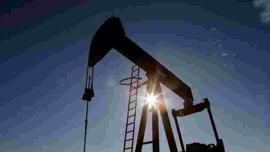 The sun is seen behind a crude oil pump jack in the Permian Basin in Loving County, Texas, US.(REUTERS)