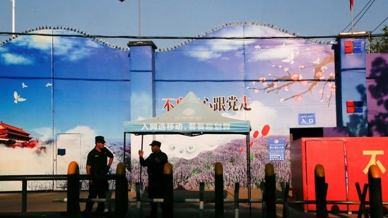 FILE PHOTO: Security guards stand at the gates of what is officially known as a vocational skills education centre in Huocheng County in Xinjiang Uighur Autonomous Region, China September 3, 2018.REUTERS/Thomas Peter/File Photo(REUTERS)