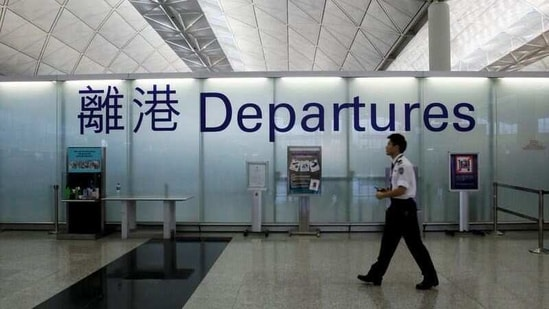 FILE PHOTO: An airport security guard walks past a sign at the departure hall of Hong Kong Airport June 23, 2013. REUTERS/Bobby Yip(REUTERS)