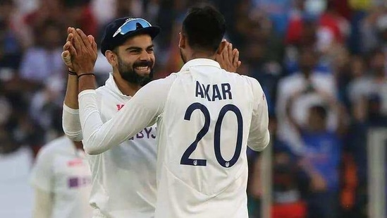 India's Axar Patel and Virat Kohli celebrate the dismissal during the 2nd day of the 3rd Test Match in the series between India and England at Narendra Modi Stadium, Motera in Ahmedabad.((ANI Photo/Virat Kohli Twitter))