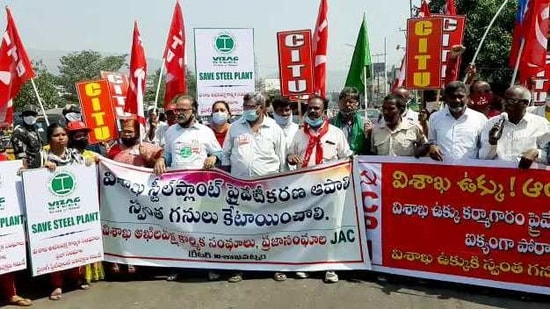 Trade Union leaders of steel plant and CITU supporters during a protest against steel plant privatization on NH 16, in Visakhapatnam on Friday. (ANI Photo)
