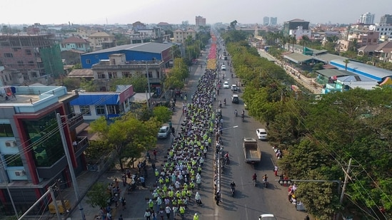 EDITORS NOTE: Graphic content / This aerial view shows protesters marching during a demonstration against the military coup in Mandalay on February 26, 2021. (Photo by STR / AFP)(AFP)