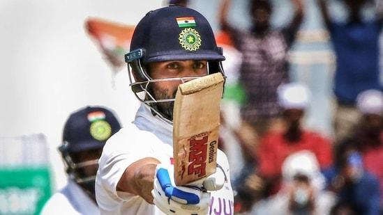 Indian Captain Virat Kohli raises his bat after scoring a half-century during the 3rd day of second cricket test match between India and England, at M.A. Chidambaram Stadium.(PTI)