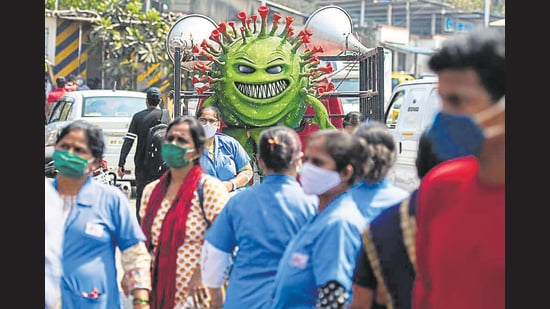 Health workers participate in a Covid-19 awareness campaign at Dharavi, on Friday. (Pratik Chorge/HT Photo)