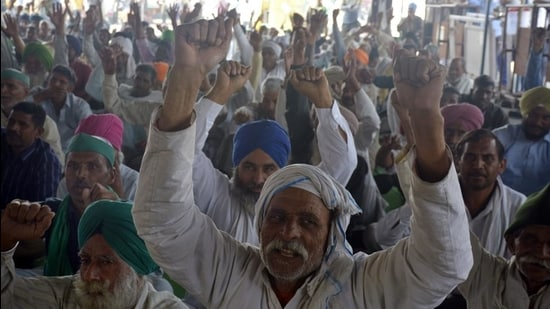 Farmers raise slogans at Ghazipur (Delhi-UP border) during the ongoing protest against the new farm laws near Ghaziabad on Thursday. (Sakib Ali/HT Photo)