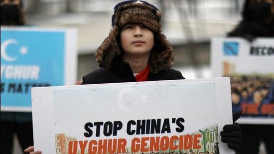 Umer Jan, 12, takes part in a rally to encourage Canada and other countries as they consider labelling China's treatment of its Uighur population and Muslim minorities as genocide, outside the Canadian embassy in Washington, DC, US on February 19, 2021. (REUTERS)